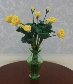 Yellow roses in green vase