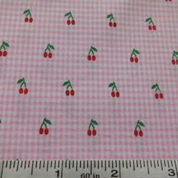 Pink checked fabric with a cherry pattern