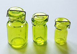 Set of three green preserving jars