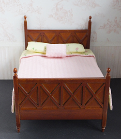 Ashley spice bed with pink/yellow bedding