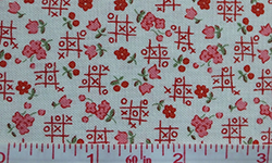 Cotton fabric with tiny flowers and noughts and crosses pattern