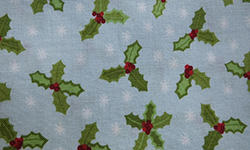 Christmas cotton, holly on blue background
