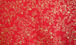 Christmas cotton, gold holly on red background